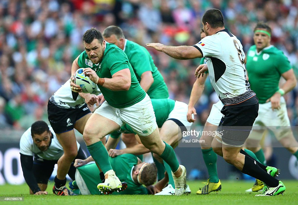 Cian Healy of Ireland breaks past Daniel Carpo of Romania during the 2015 Rugby World Cup Pool D match between Ireland and Romania at Wembley Stadium...