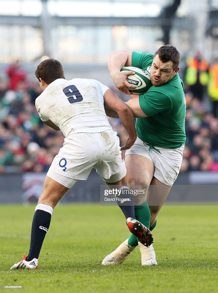 Cian Healy of Ireland brushes aside Ben Youngs of England during the RBS Six Nations match between Ireland and England at the Aviva Stadium on March...
