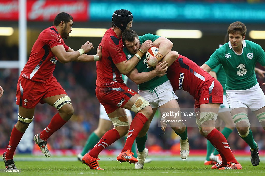 Cian Healy of Ireland is held up by Luke Charteris of Wales during the RBS Six Nations match between Wales and Ireland at the Millennium Stadium on...