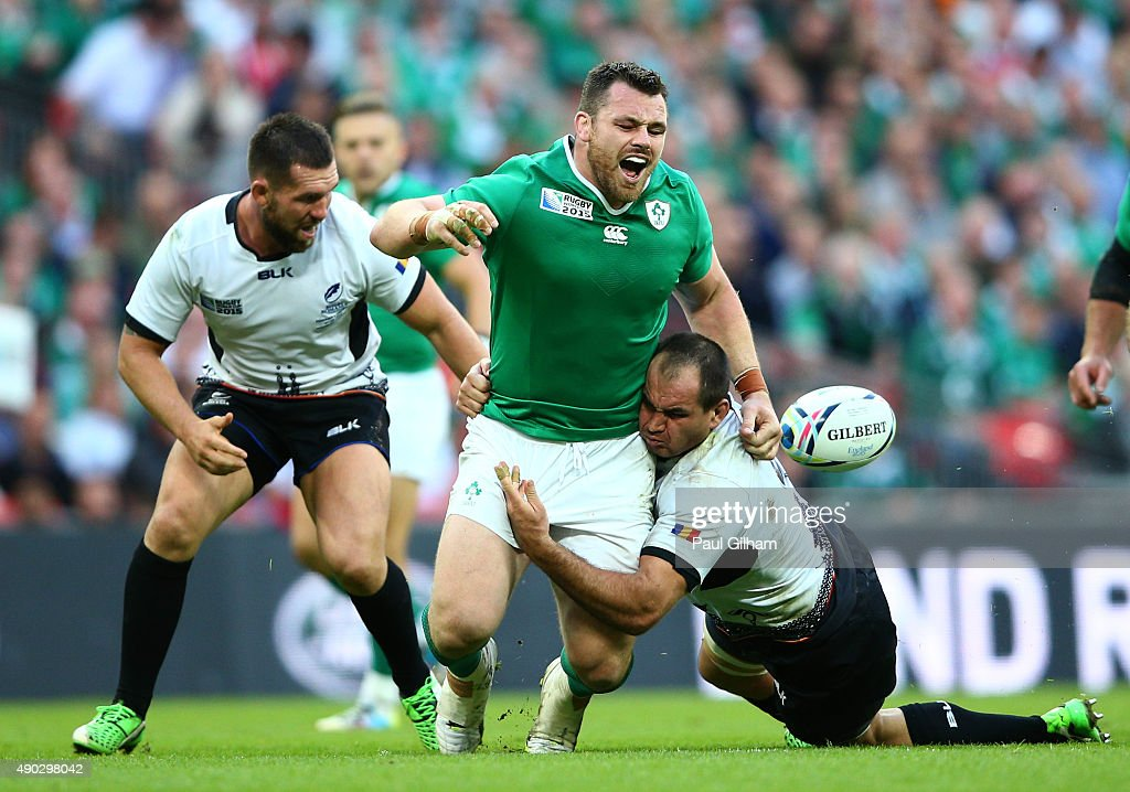 Cian Healy of Ireland is tackled by Daniel Carpo of Romania during the 2015 Rugby World Cup Pool D match between Ireland and Romania at Wembley...