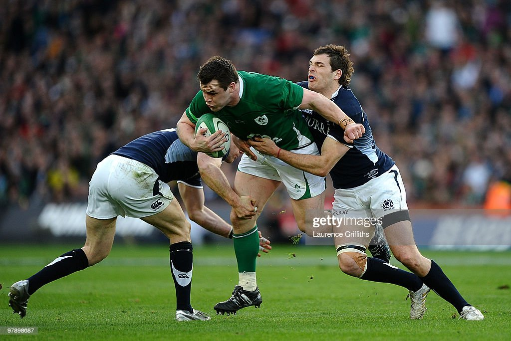 <a gi-track='captionPersonalityLinkClicked' href=/galleries/search?phrase=Cian+Healy&family=editorial&specificpeople=4166531 ng-click='$event.stopPropagation()'>Cian Healy</a> of Ireland is tackled by <a gi-track='captionPersonalityLinkClicked' href=/galleries/search?phrase=Sean+Lamont&family=editorial&specificpeople=241325 ng-click='$event.stopPropagation()'>Sean Lamont</a> and <a gi-track='captionPersonalityLinkClicked' href=/galleries/search?phrase=Graeme+Morrison&family=editorial&specificpeople=596234 ng-click='$event.stopPropagation()'>Graeme Morrison</a> of Scotland during the RBS Six Nations match between Ireland and Scotland at Croke Park on March 20, 2010 in Dublin, Ireland.