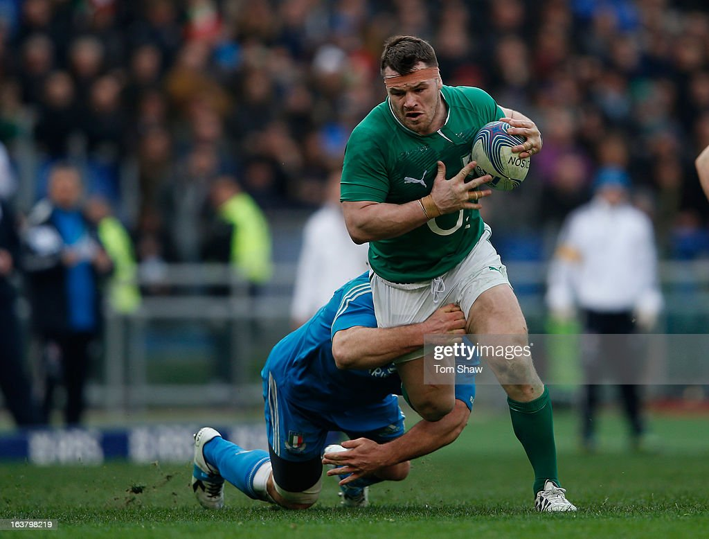 Cian Healy of Ireland is tackled during the RBS Six Nations match between Italy and Ireland at Stadio Olimpico on March 16 2013 in Rome Italy