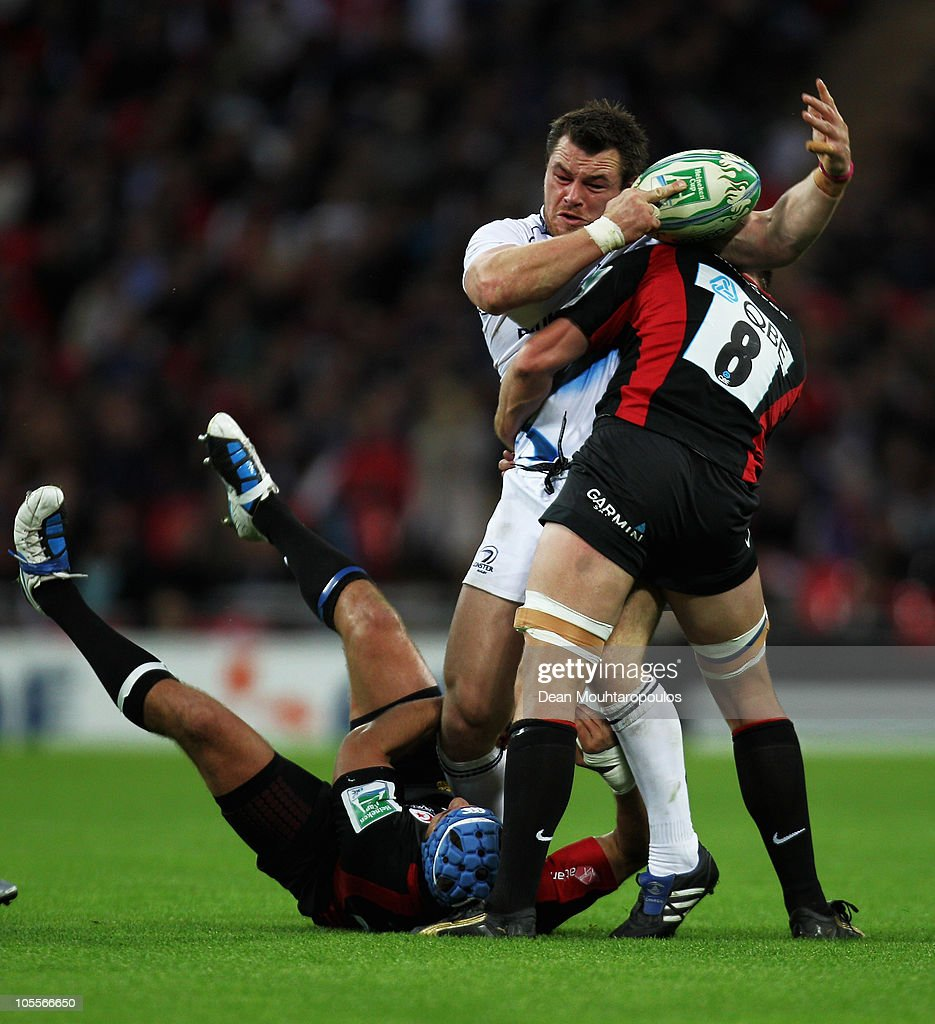 Cian Healy of Leinster is tackeld by Schalk Brits and Ernst Joubert during the Heineken Cup match between Saracens and Leinster at Wembley Stadium on...