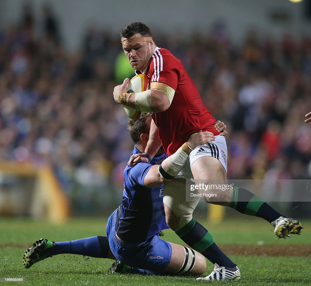 Cian Healy of the Lions is tackled by Richard Brown during the tour match between the Western Force and the British Irish Lions at Patersons Stadium...