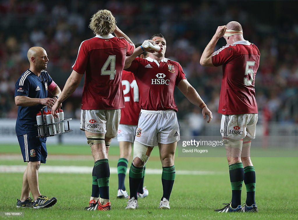 Cian Healy Paul O'Connell and Richie Gray take on liquid during a rehydration break during the match between the British Irish Lions and the...