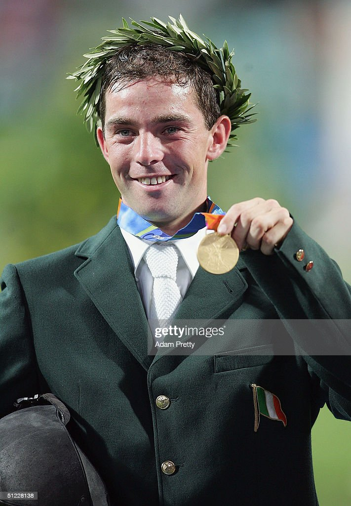 Cian O'Connor of Ireland who rode Waterford Crystal celebrates winning the gold medal in the individual show jumping event on August 27, 2004 during the Athens 2004 Summer Olympic Games at the Markopoulo Olympic Equestrian Centre Jumping Arena in Athens, Greece.