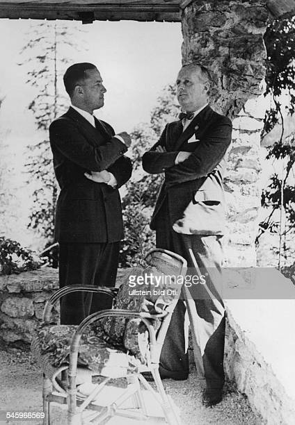 Ciano Galeazzo Politician Italy*Foreign Minister Ciano on a visit to Fuschl Ciano and a Foreign Secretary Joachim v Ribbentrop talking in the park of...