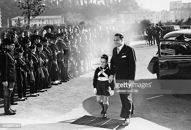 Ciano Galeazzo Politician Italy*is accompanying his son Fabrizio on his way to school in the background members of the Balilla youth organization...