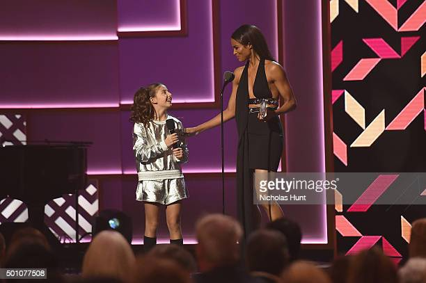 Ciara and a young dancer speak onstage during the Billboard Women in Music Luncheon on December 11 2015 in New York City