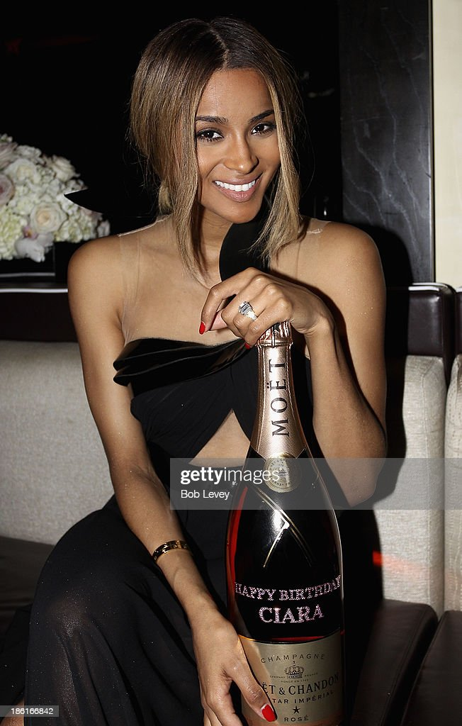 Ciara displays a custom bottle of Moet presented to her at The Hotel Derek on October 28, 2013 in Houston, Texas.