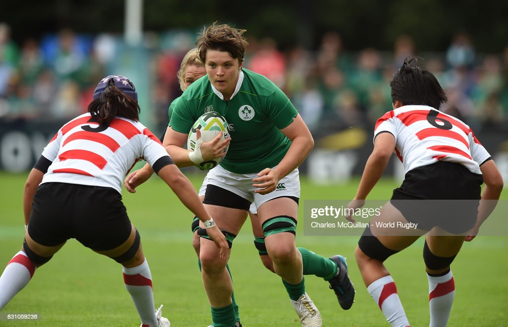 Ciara Griffin of Ireland runs at Ayano Sakurai (L) and Yuki Sue (R) of Japan during the Women's Rugby World Cup 2017 match between Ireland and Japan on August 13, 2017 in Dublin, Ireland.