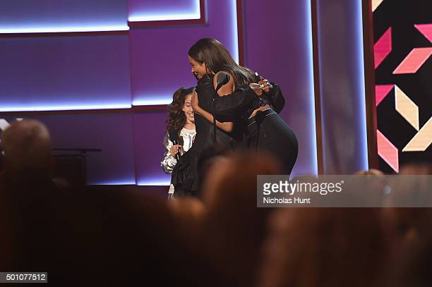 Ciara Missy Elliott and a young dancer appear onstage during the Billboard Women in Music Luncheon on December 11 2015 in New York City