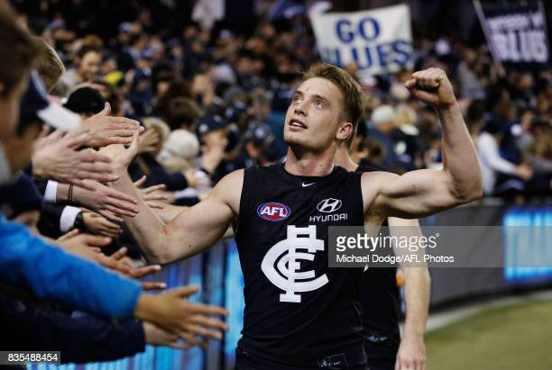Ciaran Byrne of the Blues celebrates the win with fans during the round 22 AFL match between the Carlton Blues and the Hawthorn Hawks at Etihad...