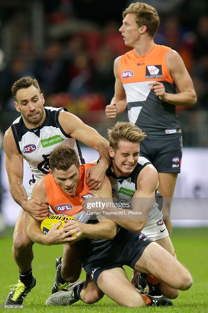 Ciaran Byrne of the Blues tackles Heath Shaw of the Giants during the round 14 AFL match between the Greater Western Sydney Giants and the Carlton Blues at Spotless Stadium on June 25, 2016 in Sydney, Australia.