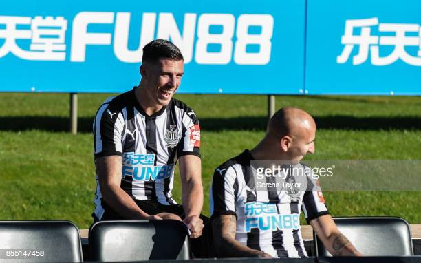 Ciaran Clark laughs with Jonjo Shelvey as they wait patiently during the Newcastle United Team photocall at the Newcastle United Training Centre on...