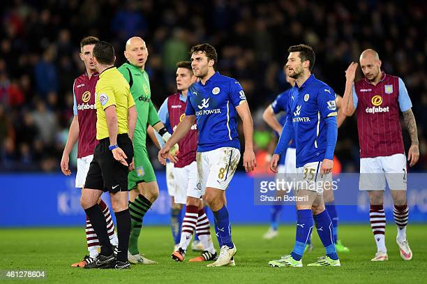 Ciaran Clark of Aston Villa and Matthew James of Leicester City react as they are shown the red card by referee Michael Oliver during the Barclays...