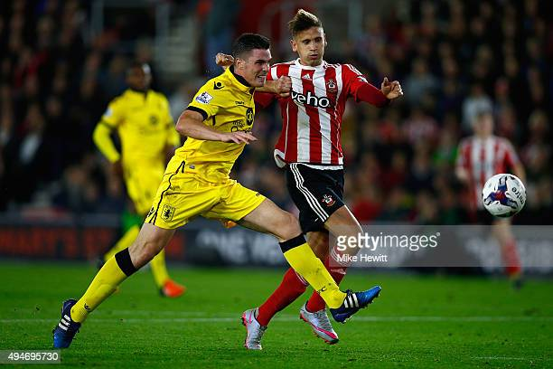 Ciaran Clark of Aston Villa challenges Gaston Ramirez of Southampton during the Capital One Cup Fourth Round match between Southampton v Aston Villa...