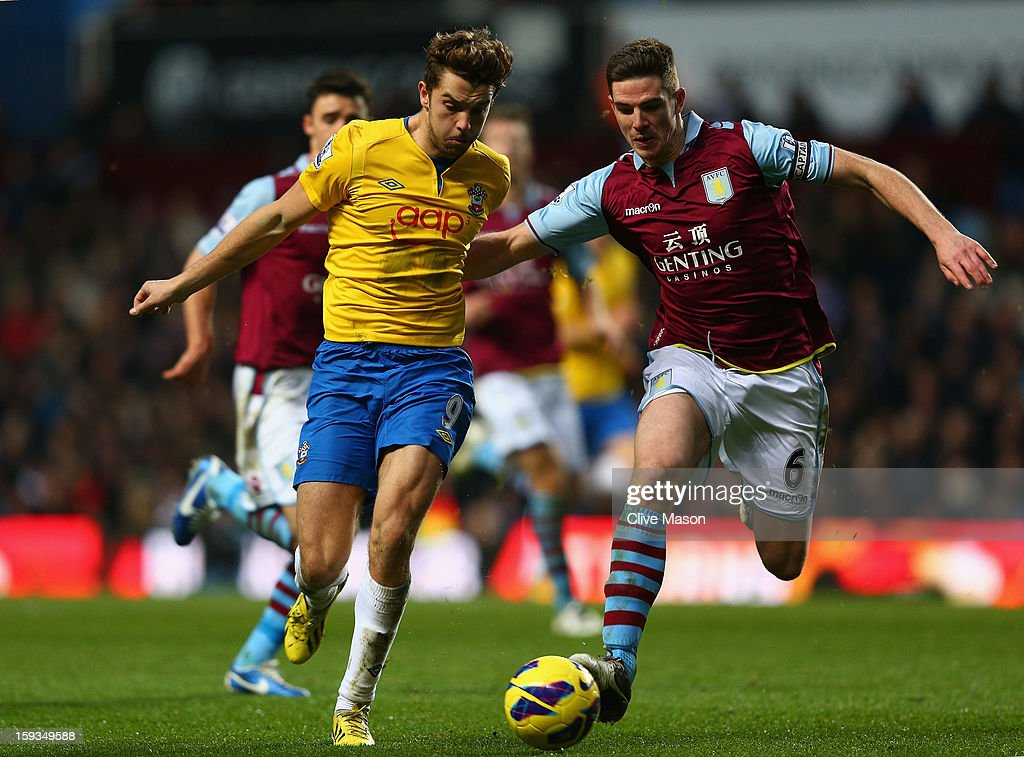 Ciaran Clark of Aston Villa challenges Jay Rodriguez of Southampton during the Barclays Premier League match between Aston Villa and Southampton at Villa Park on January 12, 2013 in Birmingham, England.
