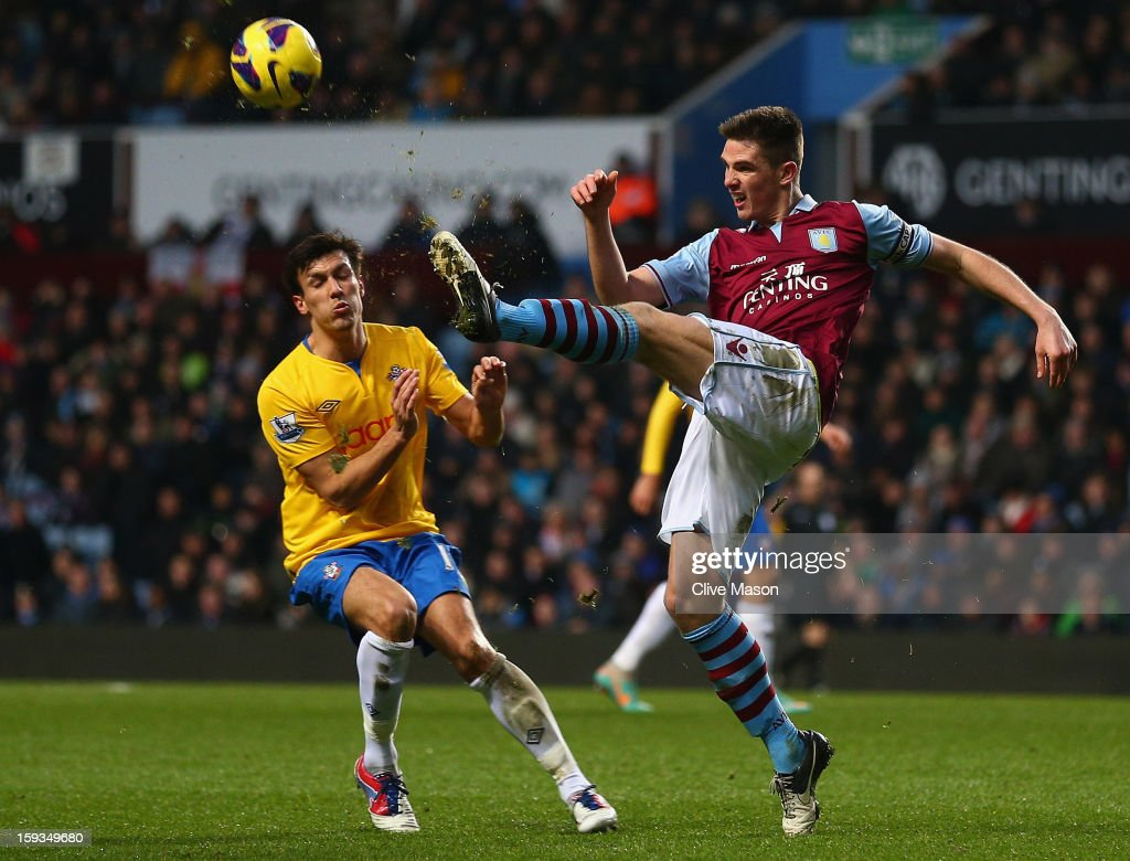 <a gi-track='captionPersonalityLinkClicked' href=/galleries/search?phrase=Ciaran+Clark&family=editorial&specificpeople=4644641 ng-click='$event.stopPropagation()'>Ciaran Clark</a> of Aston Villa clears the ball under pressure from <a gi-track='captionPersonalityLinkClicked' href=/galleries/search?phrase=Jack+Cork+-+Soccer+Player&family=editorial&specificpeople=4206991 ng-click='$event.stopPropagation()'>Jack Cork</a> of Southampton during the Barclays Premier League match between Aston Villa and Southampton at Villa Park on January 12, 2013 in Birmingham, England.