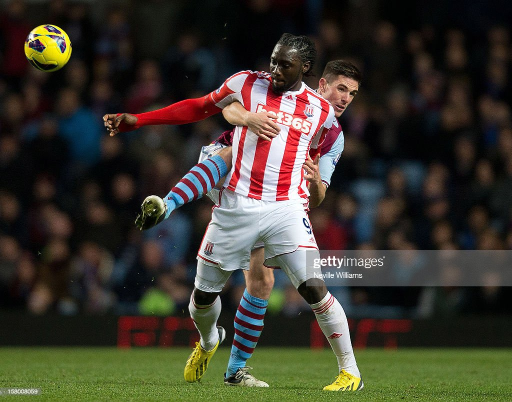 <a gi-track='captionPersonalityLinkClicked' href=/galleries/search?phrase=Ciaran+Clark&family=editorial&specificpeople=4644641 ng-click='$event.stopPropagation()'>Ciaran Clark</a> of Aston Villa competes with <a gi-track='captionPersonalityLinkClicked' href=/galleries/search?phrase=Kenwyne+Jones&family=editorial&specificpeople=553966 ng-click='$event.stopPropagation()'>Kenwyne Jones</a> of Stoke City during the Barclays Premier League match between Aston Villa and Stoke City at Villa Park on December 08, 2012 in Birmingham, England.