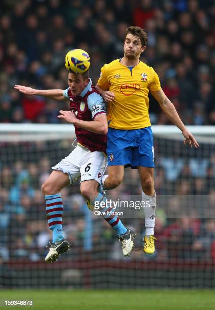 Ciaran Clark of Aston Villa holds off a challenge from Jay Rodriguez of Southampton during the Barclays Premier League match between Aston Villa and...