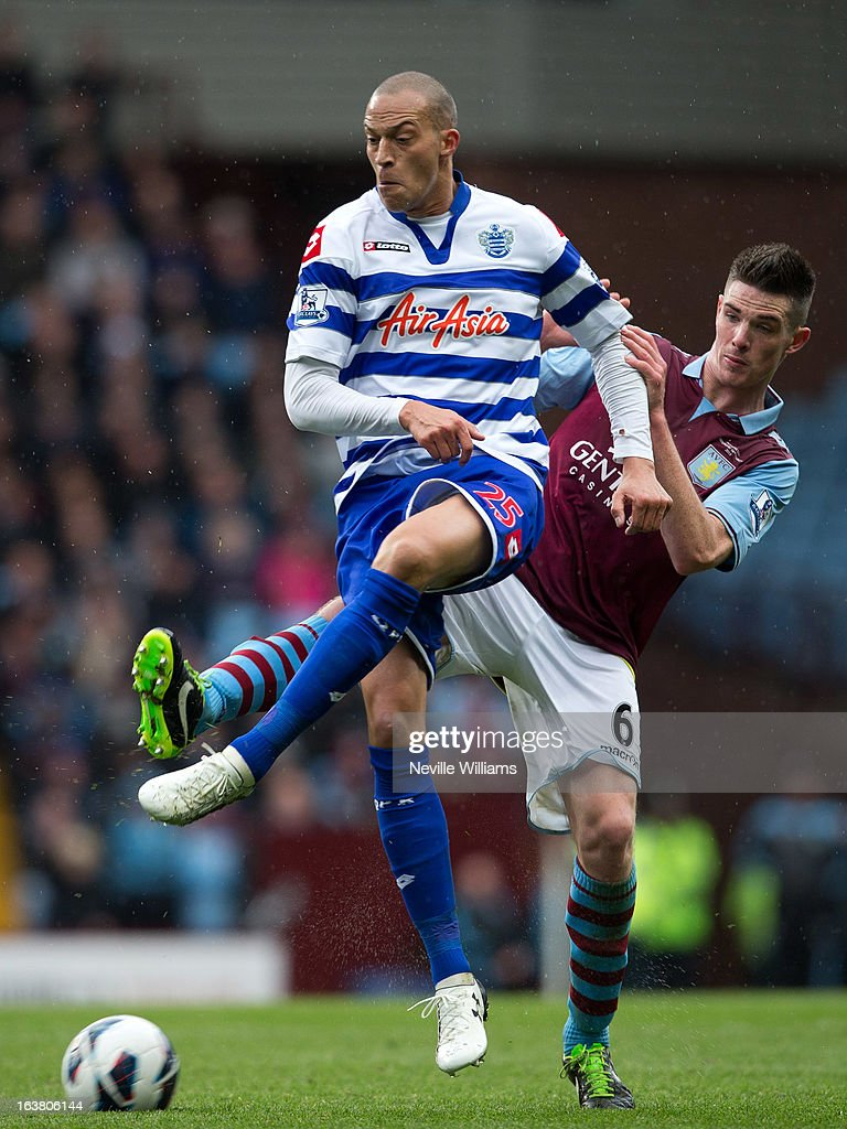 <a gi-track='captionPersonalityLinkClicked' href=/galleries/search?phrase=Ciaran+Clark&family=editorial&specificpeople=4644641 ng-click='$event.stopPropagation()'>Ciaran Clark</a> of Aston Villa is challenged by <a gi-track='captionPersonalityLinkClicked' href=/galleries/search?phrase=Bobby+Zamora&family=editorial&specificpeople=207020 ng-click='$event.stopPropagation()'>Bobby Zamora</a> of Queens Park Rangers during the Barclays Premier League match between Aston Villa and Queens Park Rangers at Villa Park on March 16, 2013 in Birmingham, England.