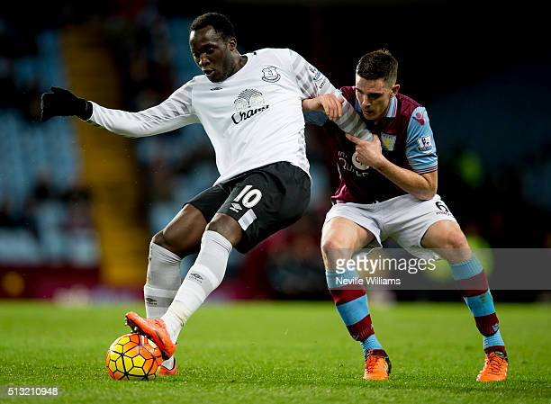 Ciaran Clark of Aston Villa is challenged by Romelu Lukaku of Everton during the Barclays Premier League match between Aston Villa and Everton at...