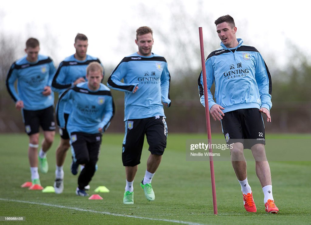 <a gi-track='captionPersonalityLinkClicked' href=/galleries/search?phrase=Ciaran+Clark&family=editorial&specificpeople=4644641 ng-click='$event.stopPropagation()'>Ciaran Clark</a> of Aston Villa trains with his team mates during a Aston Villa training session at the club's training ground at Bodymoor Heath on April 19, 2013 in Birmingham, England.
