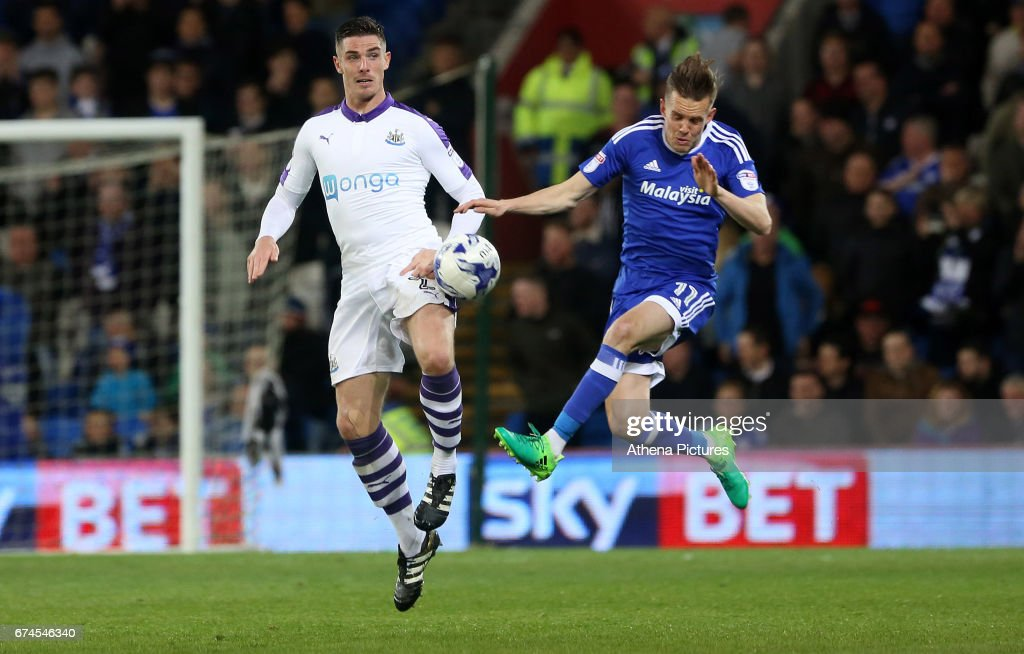 Ciaran Clark of Newcastle United and Craig Noone of Cardiff City contend for the aerial ball during the Sky Bet Championship match between Cardiff City and Newcastle United at the Cardiff City Stadium on April 28, 2017 in Cardiff, Wales.