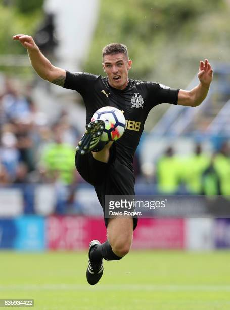 Ciaran Clark of Newcastle United controls the ball during the Premier League match between Huddersfield Town and Newcastle United at John Smith's...