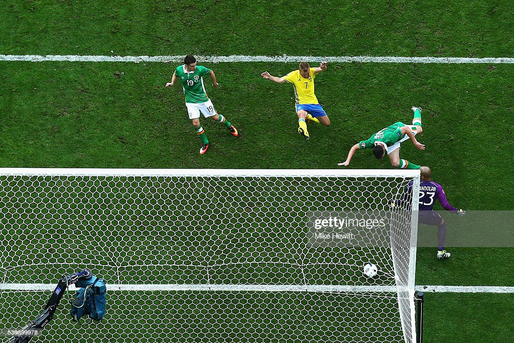 Ciaran Clark (2nd R) of Republic of Ireland heads the ball to score the own goal during the UEFA EURO 2016 Group E match between Republic of Ireland and Sweden at Stade de France on June 13, 2016 in Paris, France.