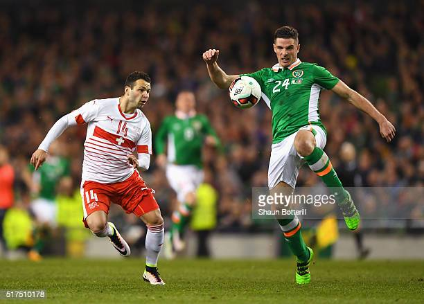 Ciaran Clark of Republic of Ireland is closed down by Renato Steffen of Switzerland during the International Friendly match between Republic of...