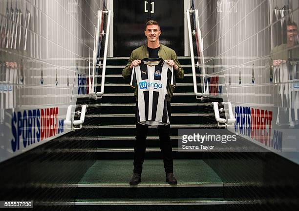 Ciaran Clark poses for photographs in the tunnel holding a home shirt at StJames' Park on August 2 in Newcastle upon Tyne England
