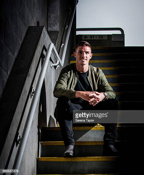 Ciaran Clark poses for photographs on the steps at StJames' Park on August 2 in Newcastle upon Tyne England