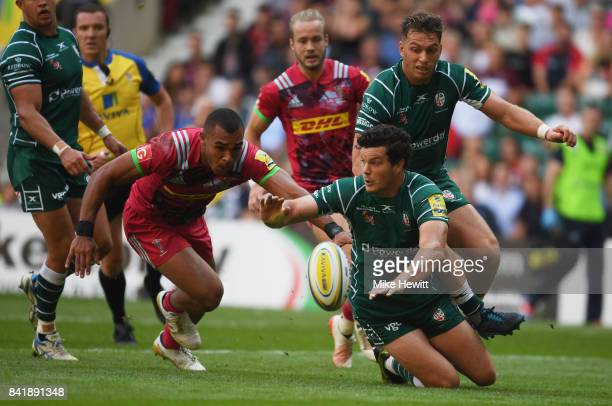 Ciaran Hearn of London Irish and Joe Marchant of Harlequins scramble for the ball during the Aviva Premiership match between London Irish and...