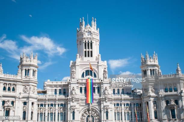 Cibeles Palace flying gay pride colors, Madrid, Spain