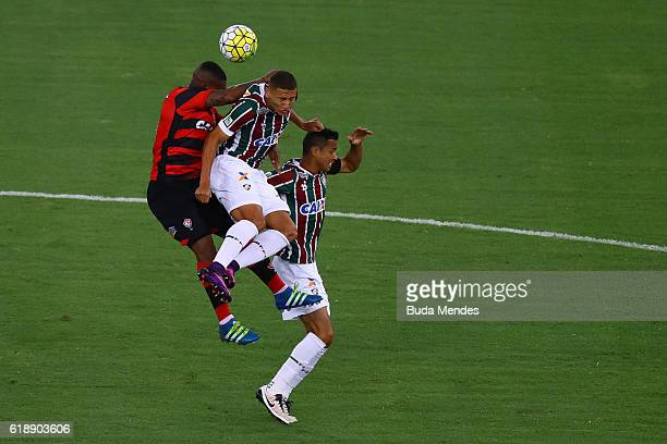 Cicero and Richarlison of Fluminense struggle for the ball with Amaral of Vitoria during a match between Fluminense and Vitoria as part of...