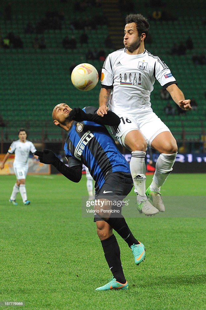 Cicero Moreira Jonathan (L) of FC Internazionale Milano clashes with Bruno Bertucci of Neftci PFK during the UEFA Europa League group H match between FC Internazionale Milano and Neftci PFK on December 6, 2012 in Milan, Italy.