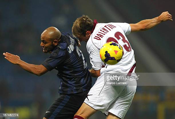 Cicero Moreira Jonathan of FC Internazionale Milano competes for the ball with Nahuel Valentini of AS Livorno Calcio during the Serie A match between...
