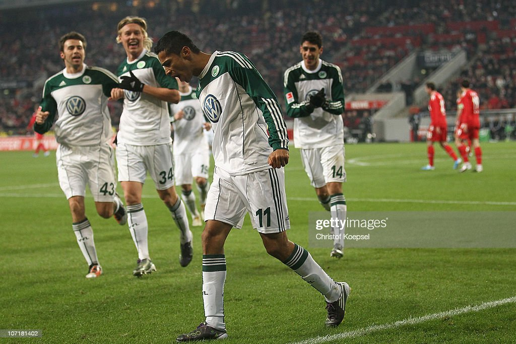 Cicero of Wolfsburg (R) celebrates the first goal with Andrea Barzagli (L), Simon Kjaer of Wolfsburg (2nd L) and Tolga Cigerci (R) during the Bundesliga match between 1. FC Koeln and VfL Wolfsburg at RheinEnergieStadion on November 28, 2010 in Cologne, Germany.