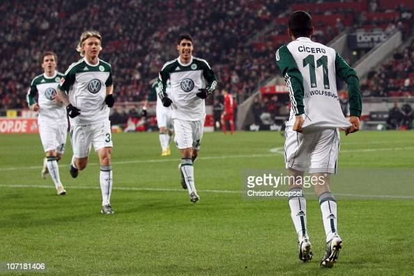 Cicero of Wolfsburg celebrates the first goal with Simon Kjaer of Wolfsburg and Tolga Cigerci of Wolfsburg during the Bundesliga match between 1 FC...