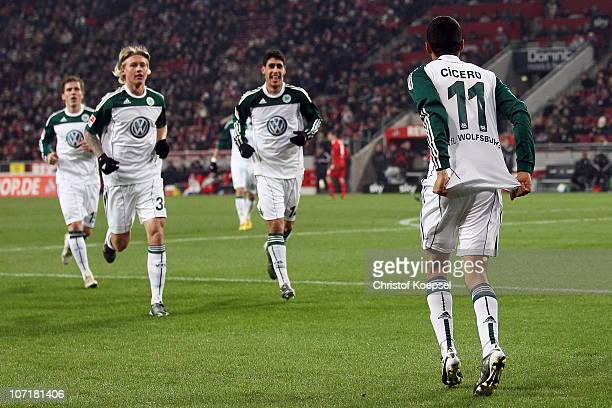 Cicero of Wolfsburg celebrates the first goal with Simon Kjaer of Wolfsburg and Tolga Cigerci of Wolfsburg during the Bundesliga match between 1 FC...