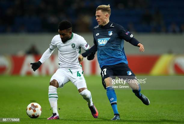Cicinho of PFC Ludogorets Razgrad holds off pressure from Robin Hack of 1899 Hoffenheim during the UEFA Europa League group C match between 1899...