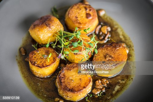 Cider fondant potatoes with thyme : Stock Photo