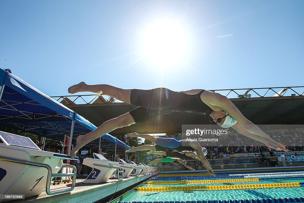 Cierra Runge (lane 1), Jessica Hardy (lane 2) and Dana Collmer (lane 3) dive to begin the Women's 100 meter free style to begin during Day Two of the Santa Clara International Grand Prix at the George F. Haines International Swim Center on May 31, 2013 in Santa Clara, California.