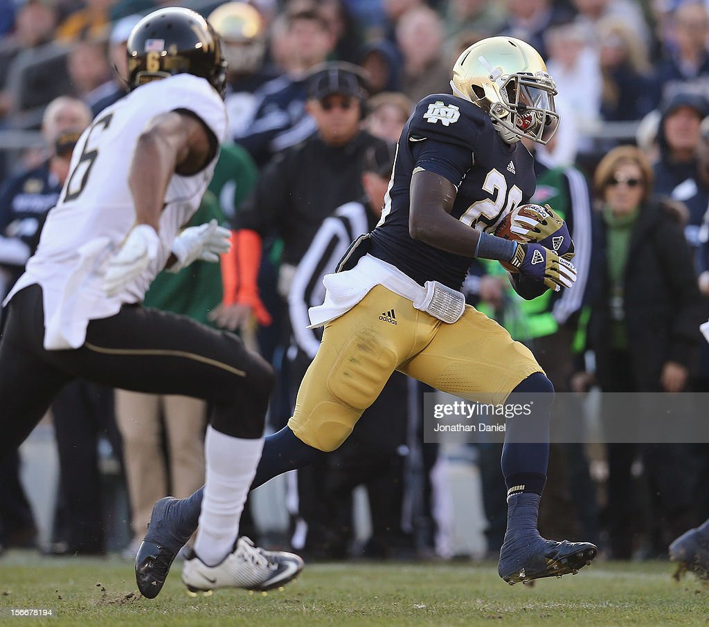 Cierre Wood #20 of the Notre Dame Fighting Irish is chased by Chibuikem Okoro #6 of the Wake Forest Demon Deacons at Notre Dame Stadium on November 17, 2012 in South Bend, Indiana. Notre Dame defeated Wake Forest 38-0.