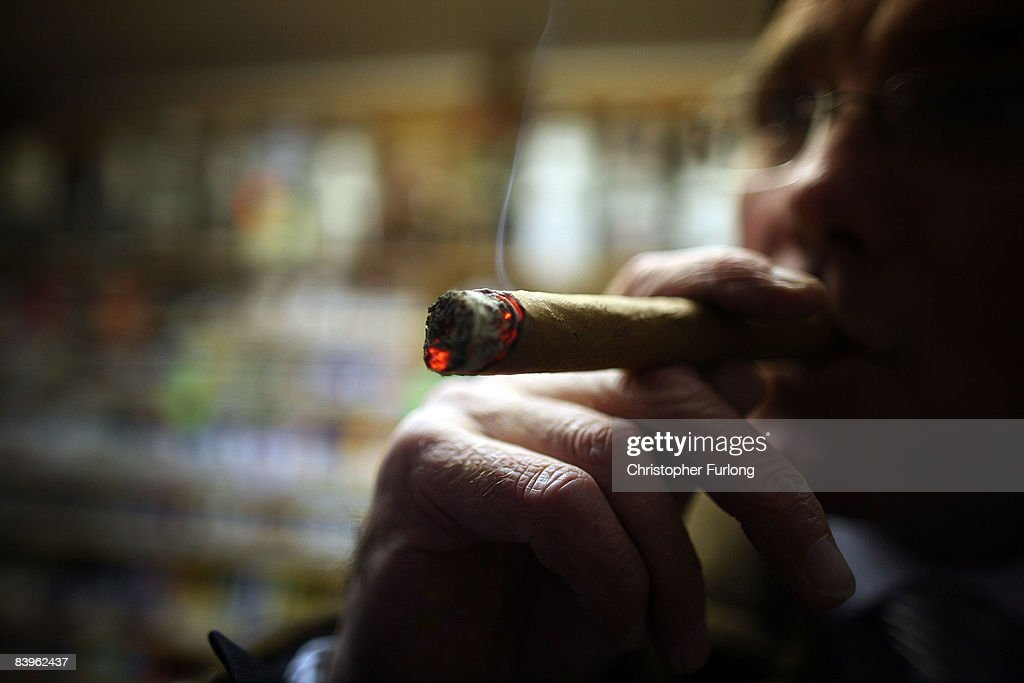Cigar lover Paul Clarke samples a Havana cigar in Turmeau's Liverpool's last remaining tobacconist shop on December 9 in Liverpool England The UK...
