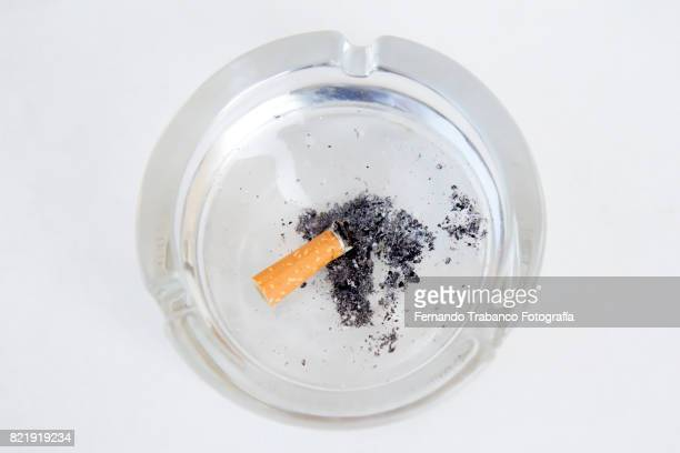 Cigarette and ash in an ashtray