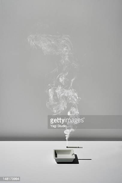 Cigarette and ashtray with white background
