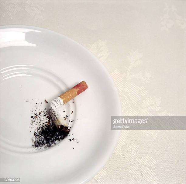 A cigarette belonging to actress Joan Collins during a portrait shoot in London UK